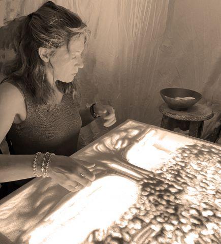 Online voorstelling van de zandkunstenares